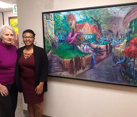 """St. Peter's Anglican Church in Mt. Brook, Alabama. Pictured: Miriam McClung, artist (left), Kat Ladd, curator (right). """"Good Friday at Five Points"""" by Miriam McClung, oil on linen."""