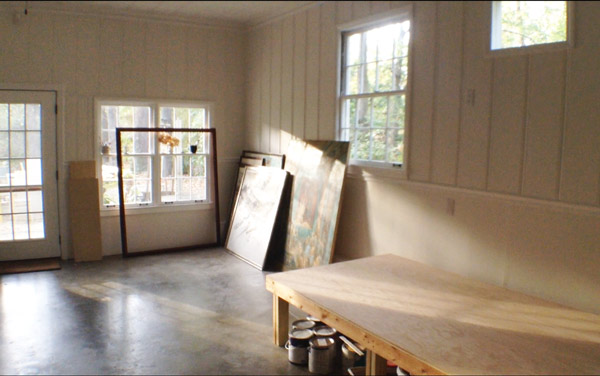 Moving artwork back into the studio after the 2014 flood.