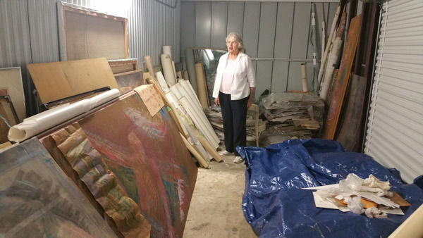 Miriam surveying her artwork in storage while the studio flood remediation and remodeling work is done.