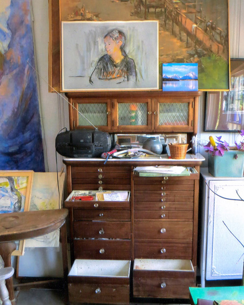 The old dental cabinet of Miriam's husband now used to store art supplies.