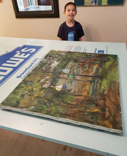 The artwork getting ready to be packed. Grandson Peter helping.